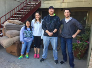 Staff members from Catalyst Teen Center pose with furniture they helped deliver to a CPRC mom as part of a partnership with Covenant Presbyterian's Movin' and Groovin' ministry to the homeless.
